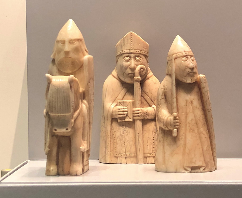 On display in the British Museum the Lewis Chessmen a Knight riding a horse, Bishop holding a staff and bible, a Pawn holding a sword