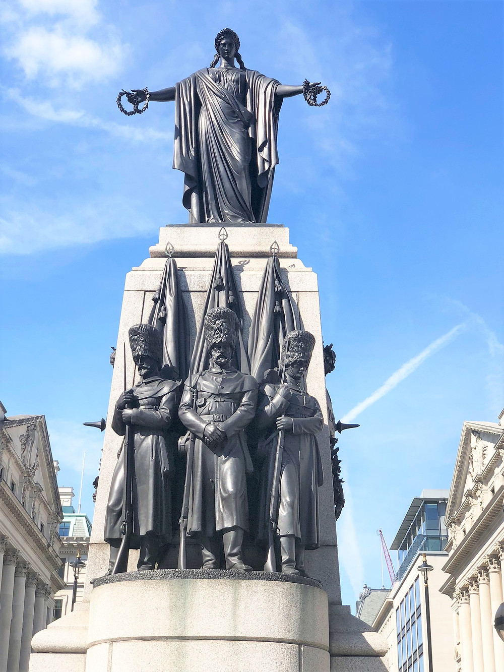 Female bronze statue referred to as Honor atop the Guards Crimean War Memorial in London