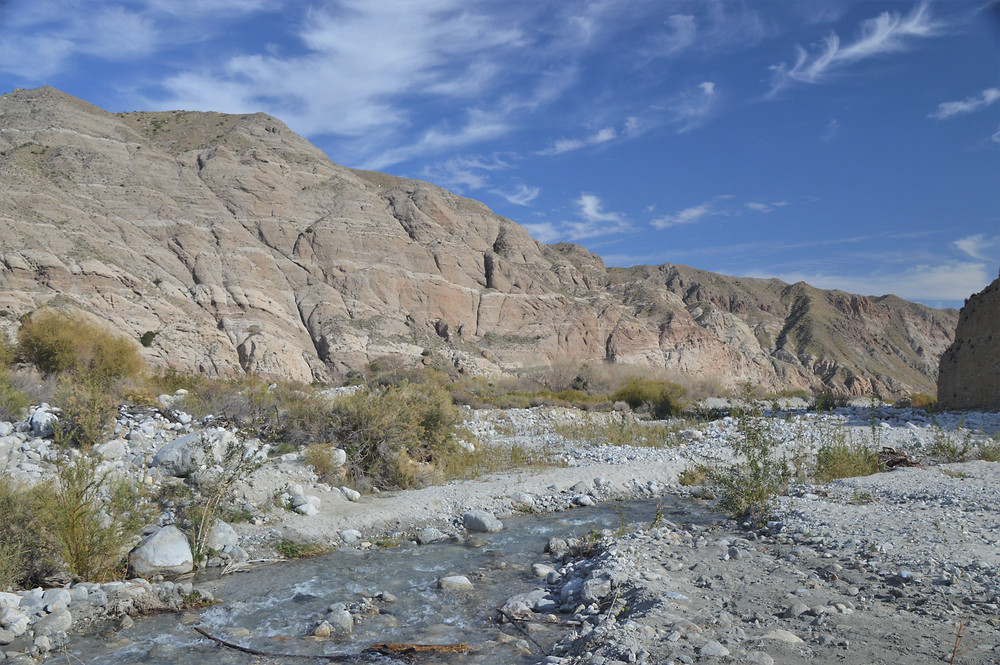Whitewater River with towering canyon walls of Whitewater Preserve