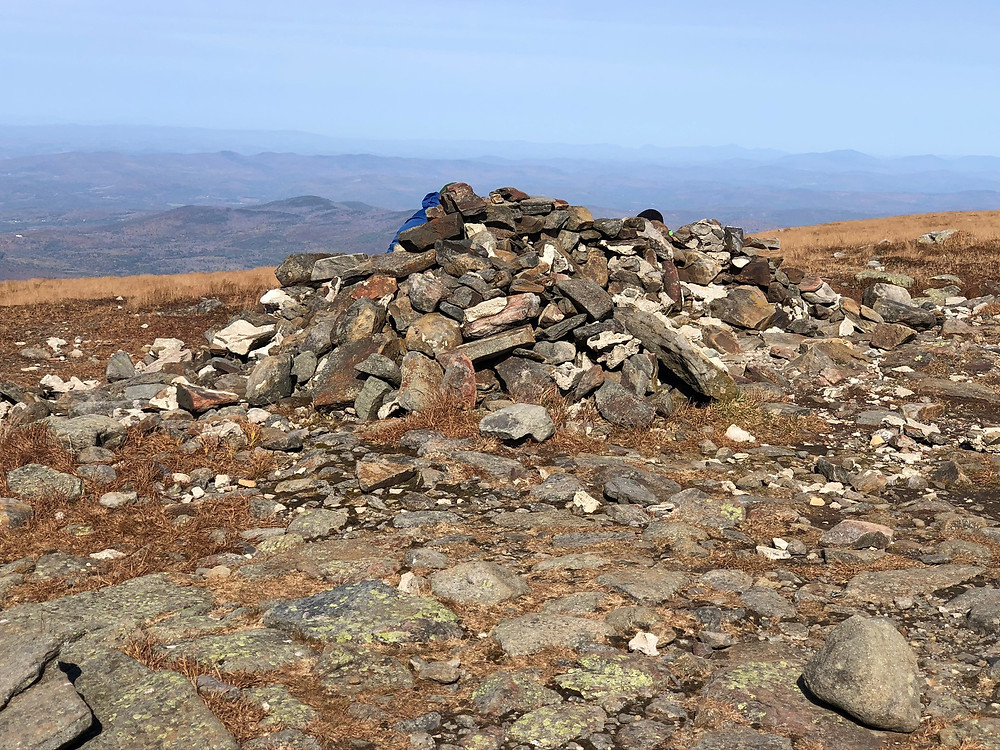 Taking shelter behind rock wall on the summit of Mt Moosilauke in NH.  NH 4000 footer