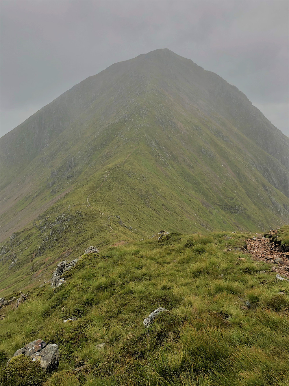 The daunting peak of Stob Na Doire and the faint traces of the trail that snakes down along the ridge.