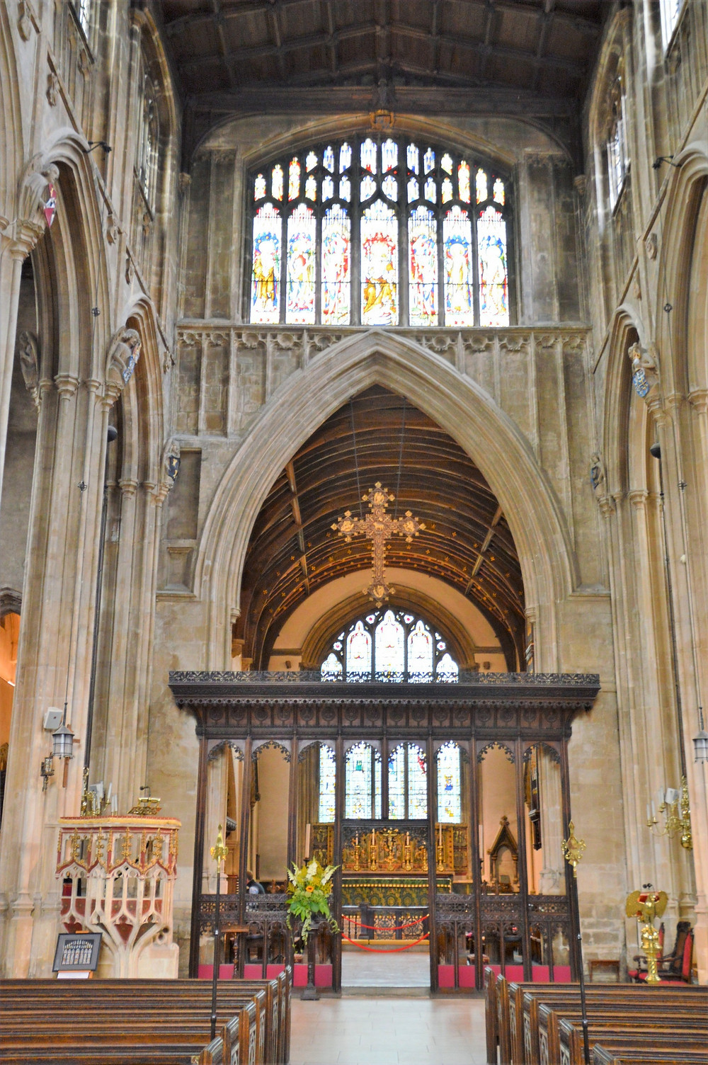 Colorful pulpit and high altar in Cathedral of the Cotswolds, St. John the Baptist in Cirencester of the Cotswolds