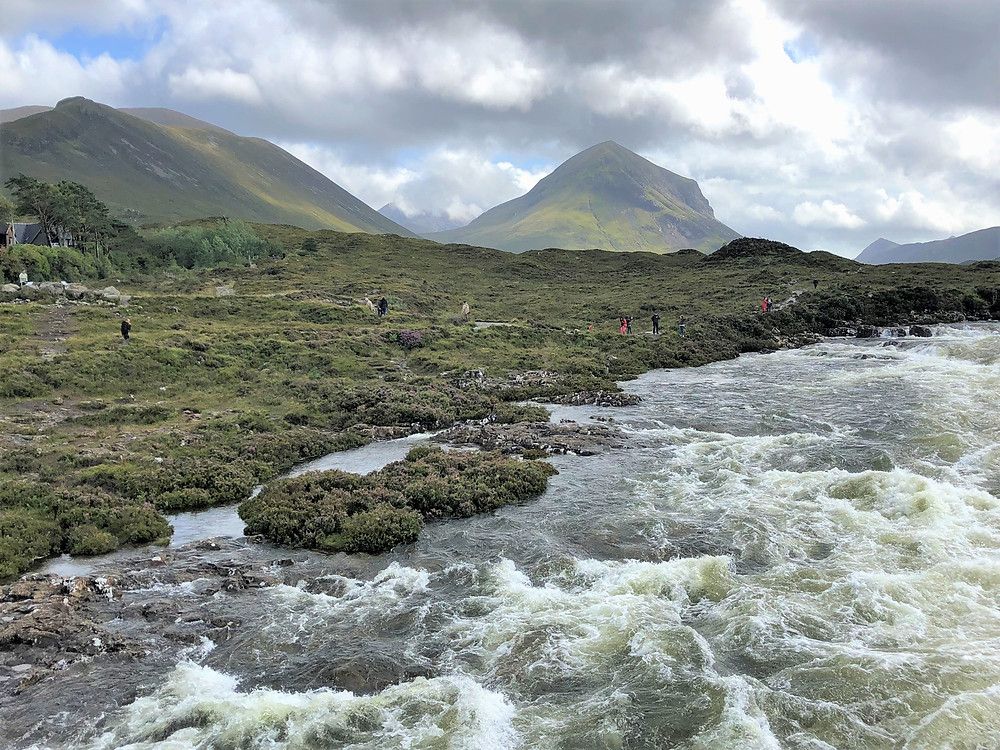Pyramidal peak of Sgurr nan Gillean  and views of the Black Cuillin Mountains from Sligacman Bridge in Skye and the mountain fed waters