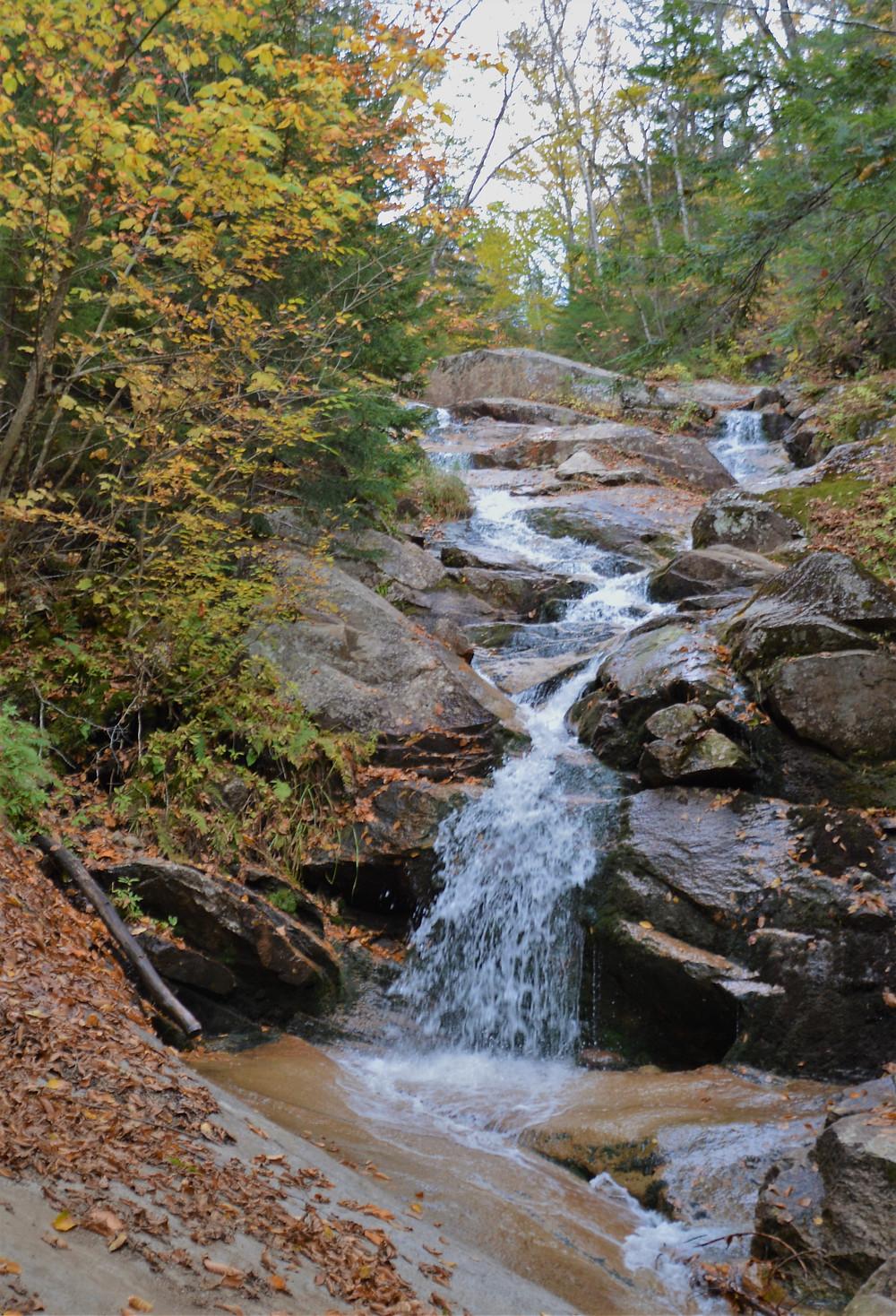 Swiftwater Falls along Falling Water Trail in Franconia Mountains. White Mountain waterfalls.