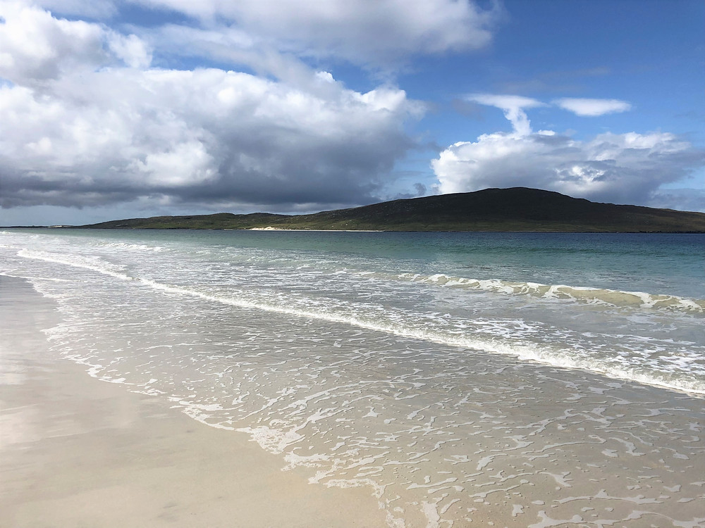 Crystal clear water and white sand on Luskentyre Beach in Lewis and Harris in the Outer Hebrides