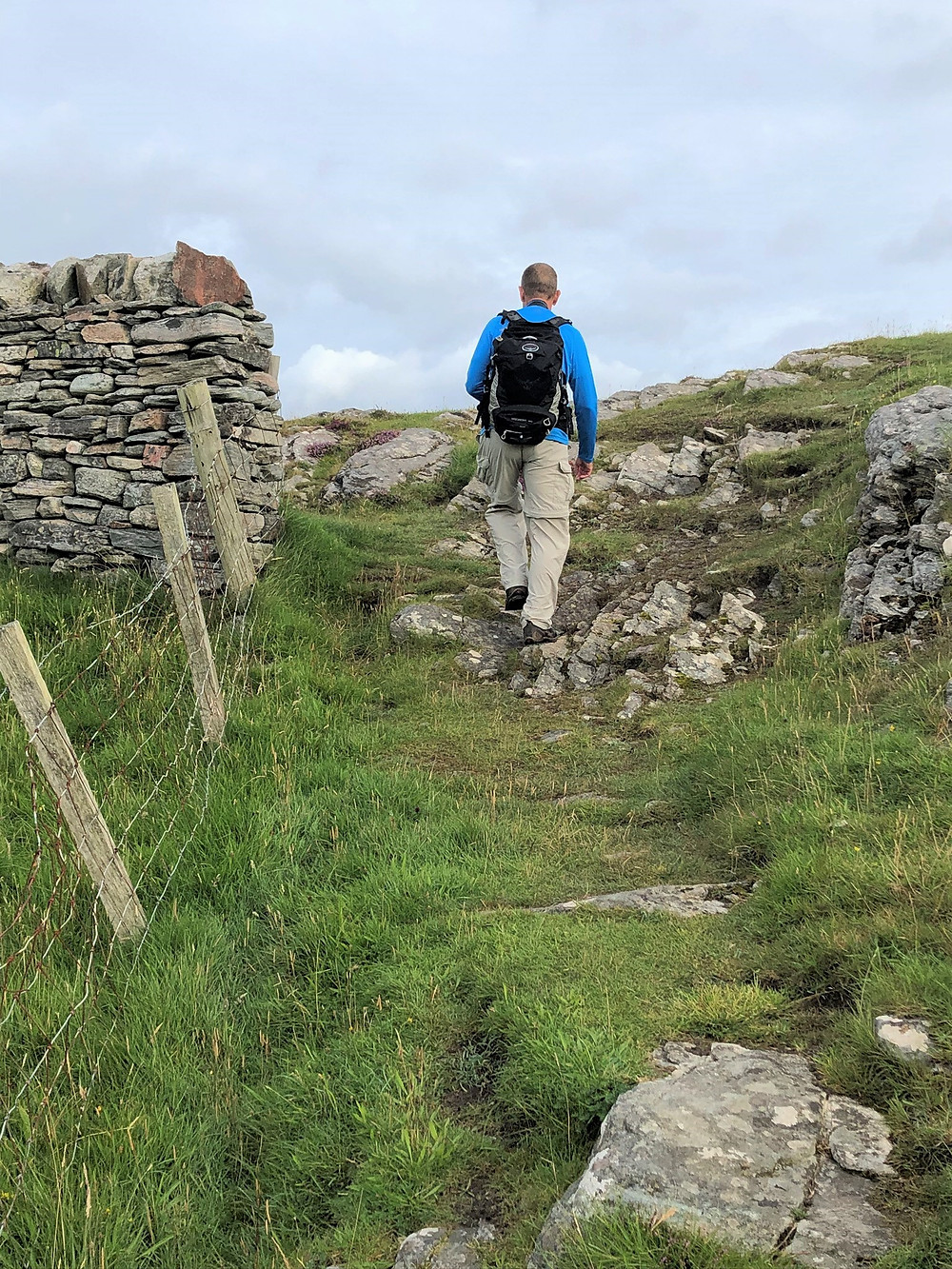 Hiking through fields on Great Bernera Loop hike on the NW coast of Isle of Lewis, Outer Hebrides
