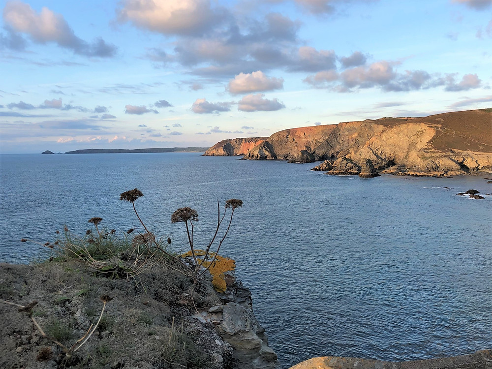 Setting sun along Cornwall coast in St Agnes, England