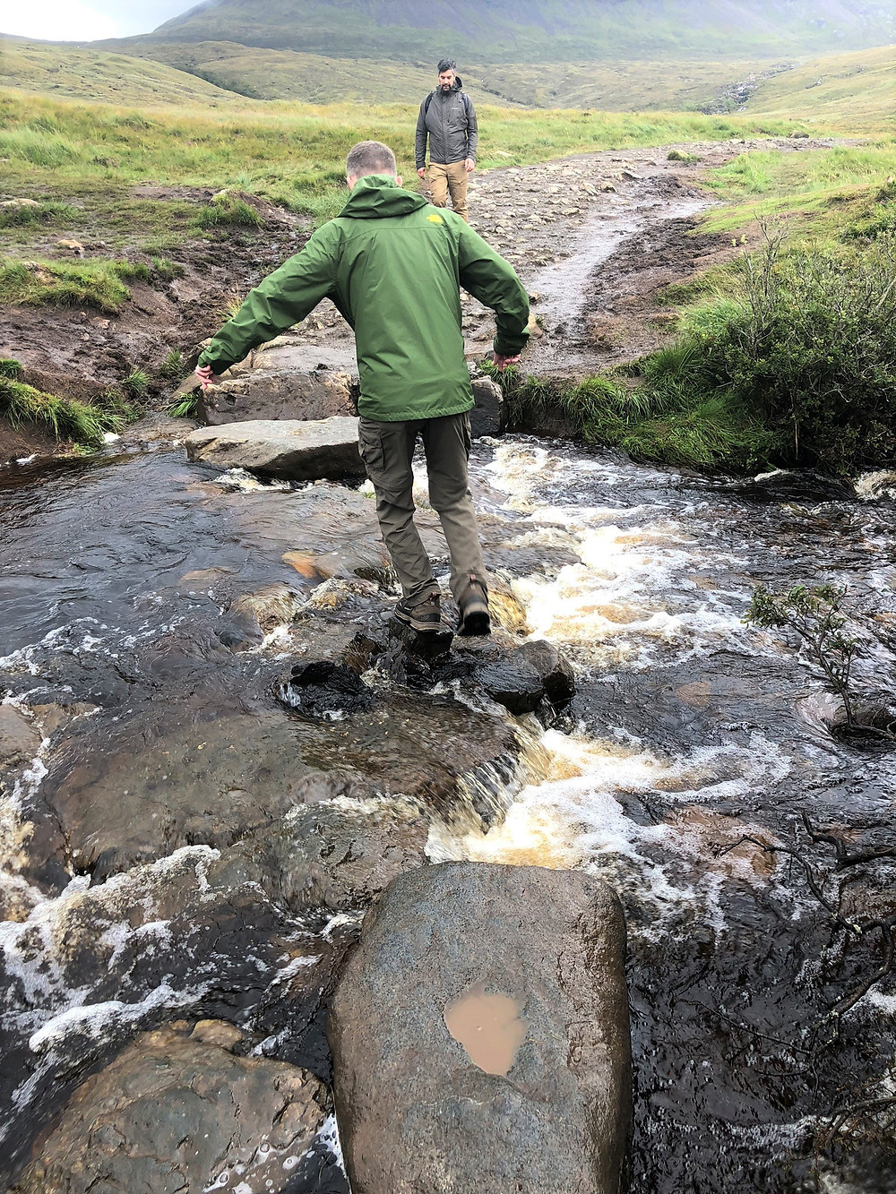 Crossing the stream at Fairy Pools on the Isle of Skye