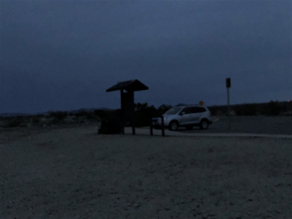 Returning to car in the dark after summitting Pinto Mountains in Joshua Tree National Park