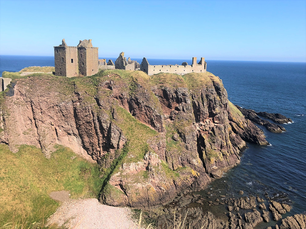 Dunnottar Castle surrounded by almost sheer cliffs on three sides that drop over 150 feet into the North Sea