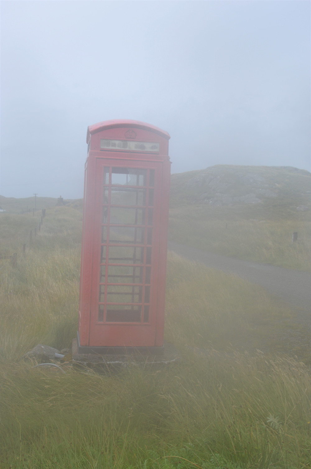 Fog cover landscape and telephone booth on Lewis and Harris in the Outer Hebrides