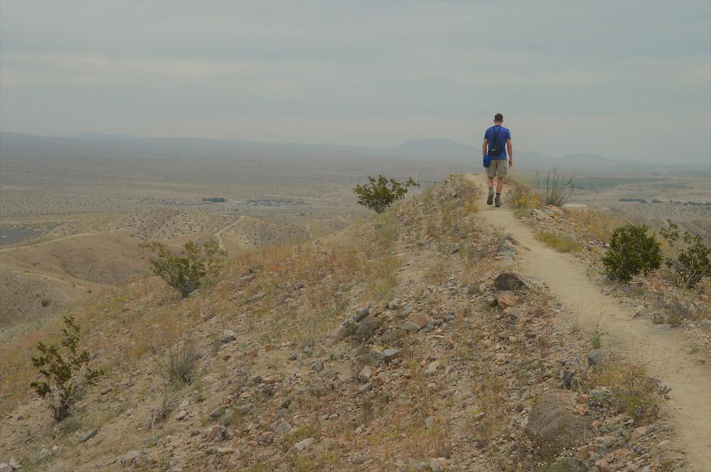 Hiking along a ridge on the Indio Hills Badlands trail