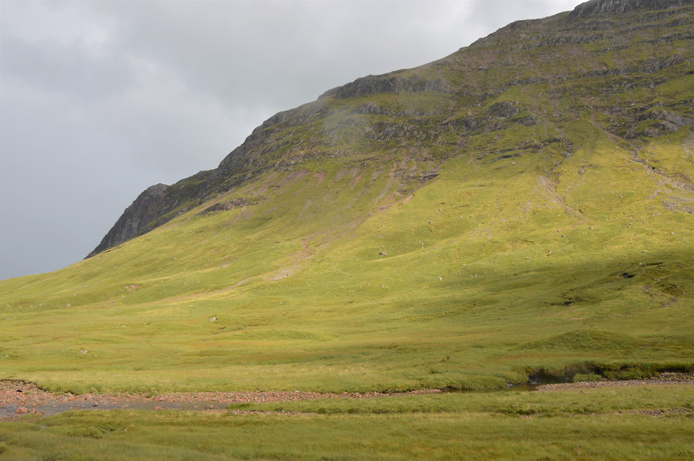 Green rolling hills of Glen Etive in the Scottish Highlands
