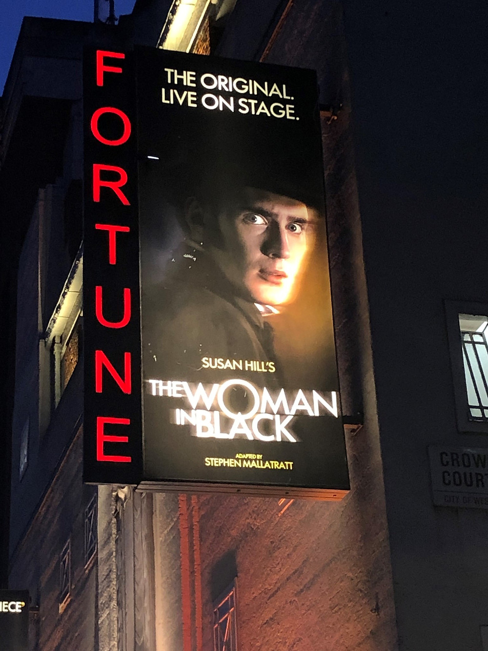 Theatre marquee for play 'The Woman in Black' at the Fortune Theatre in London