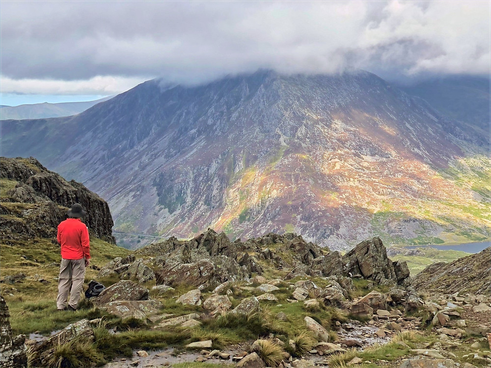 The 3,209 foot summit of Pen yr Ole Wen covered in clouds viewed from the top of Devil's Kitchen in Snowdonia