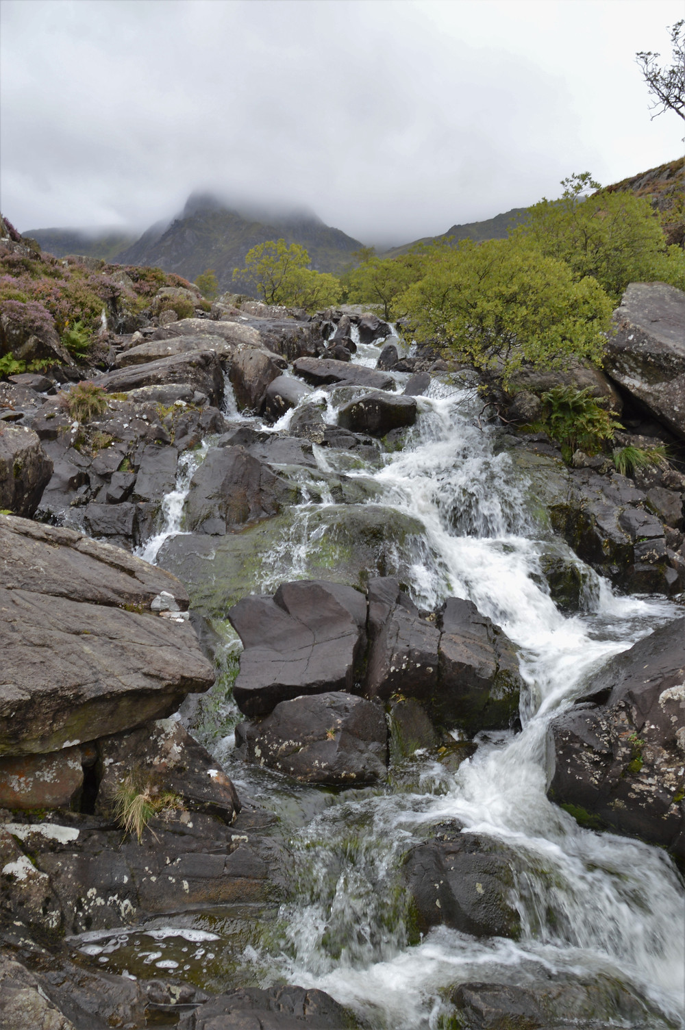 The water of Llyn Idwal cascading over rocks on the trail leading to Devil's Kitchen in Snowdonia