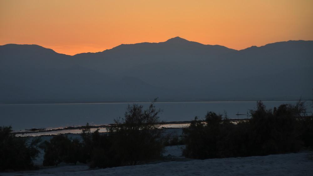 Sun setting over the Santa Rosa Mountains at Salton Sea
