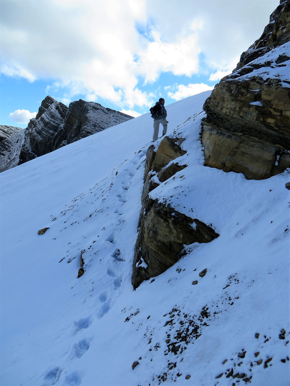 hiking siyeh pass, snow covered trail