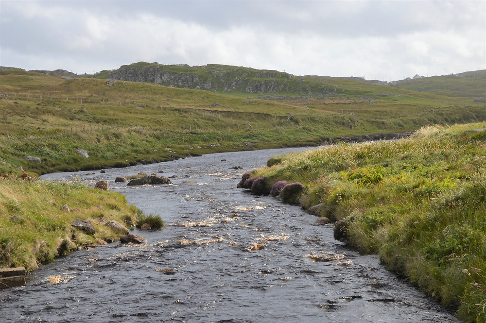 Walking along the banks of the Heidagul River in Carloway on Lewis and Harris in the Outer Hebrides