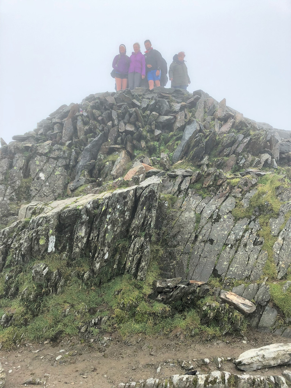 Few people on the cloud covered Snowdon summit