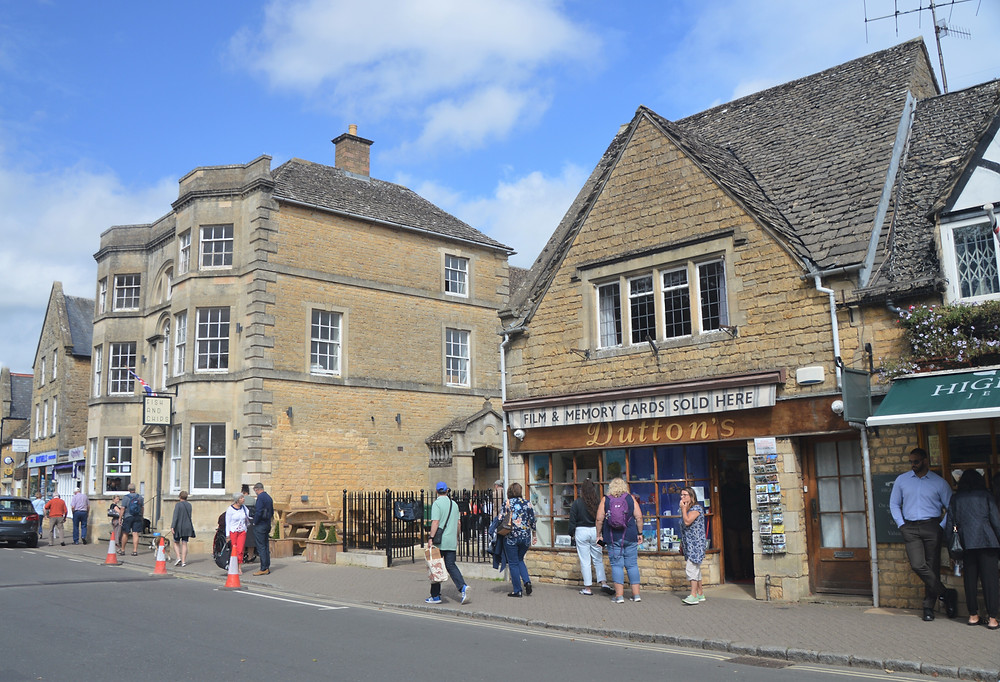 Main street in Burton-on-the-Water in Cotswolds. Shops constructed of Cotswold yellow limestone