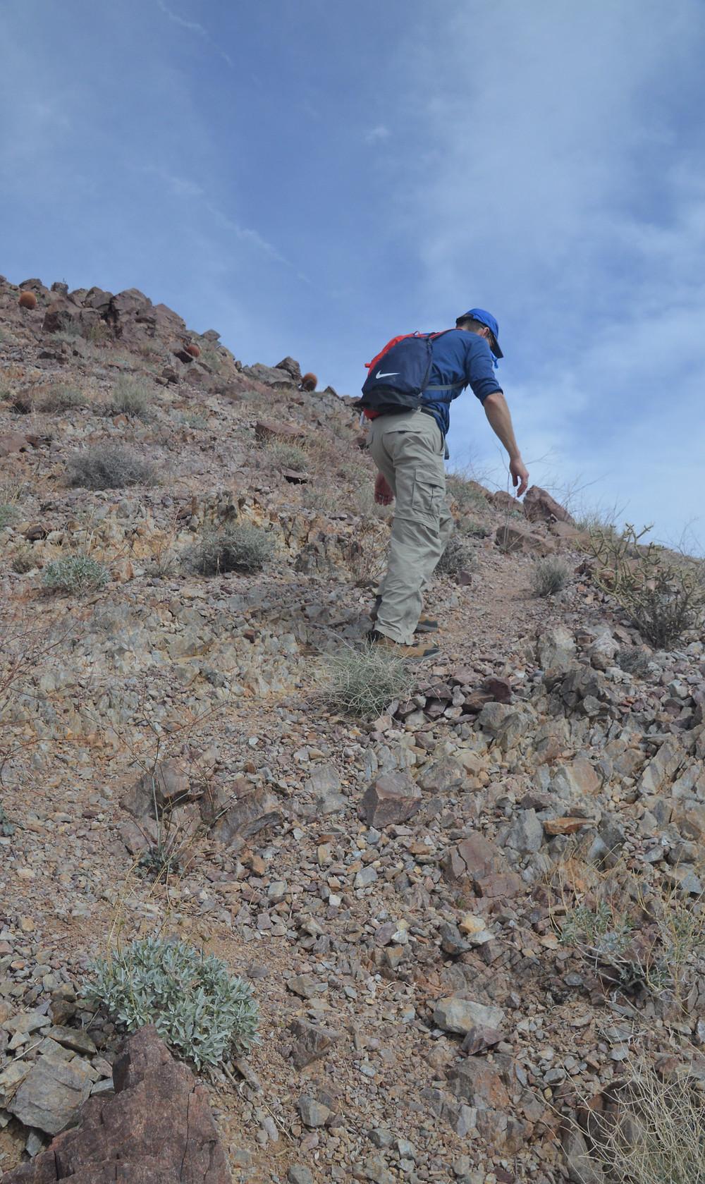Hiking ridgeline on path to Pinto Mountain summit in Joshua Tree National Park