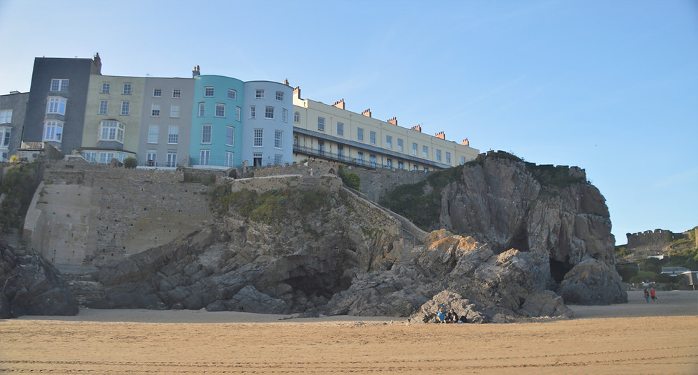 Cliff top buildings along beach in Tenby, Wales