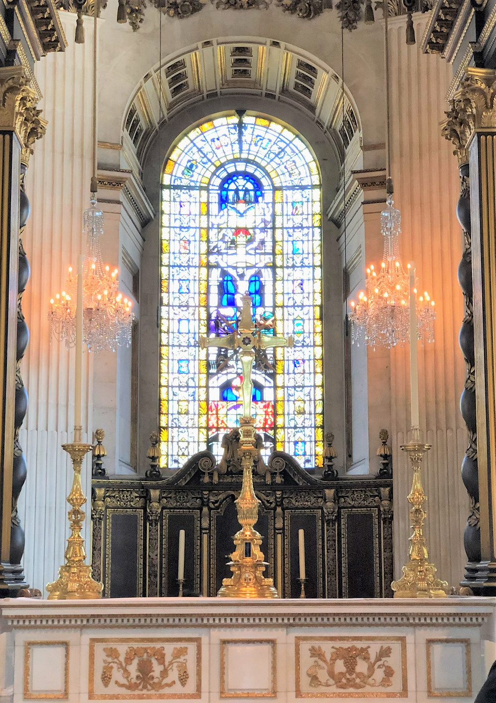 On the high altar in St Paul's Cathedral is a large cross that stands nearly 10 ft tall with a silver enameled base embellished with amethyst.