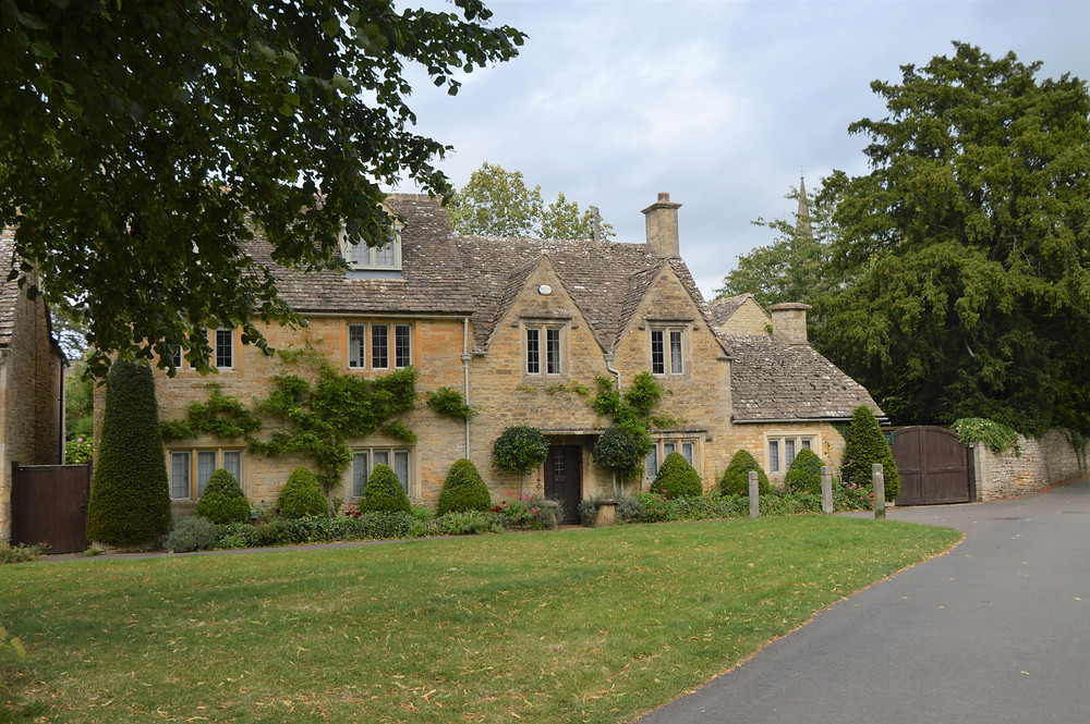 Homes made of Cotswold yellow limestone in Lower Slaughter. Cotswolds.