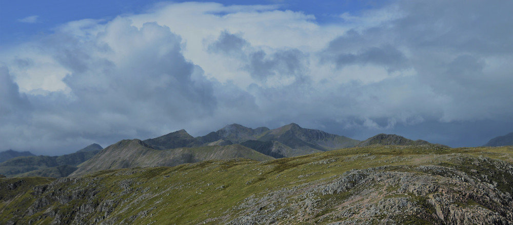 View of the Scottish Highlands mountains and valleys from the summit of Stob Dearg on Buachaille Etive Mòr in the Scottish Highlands