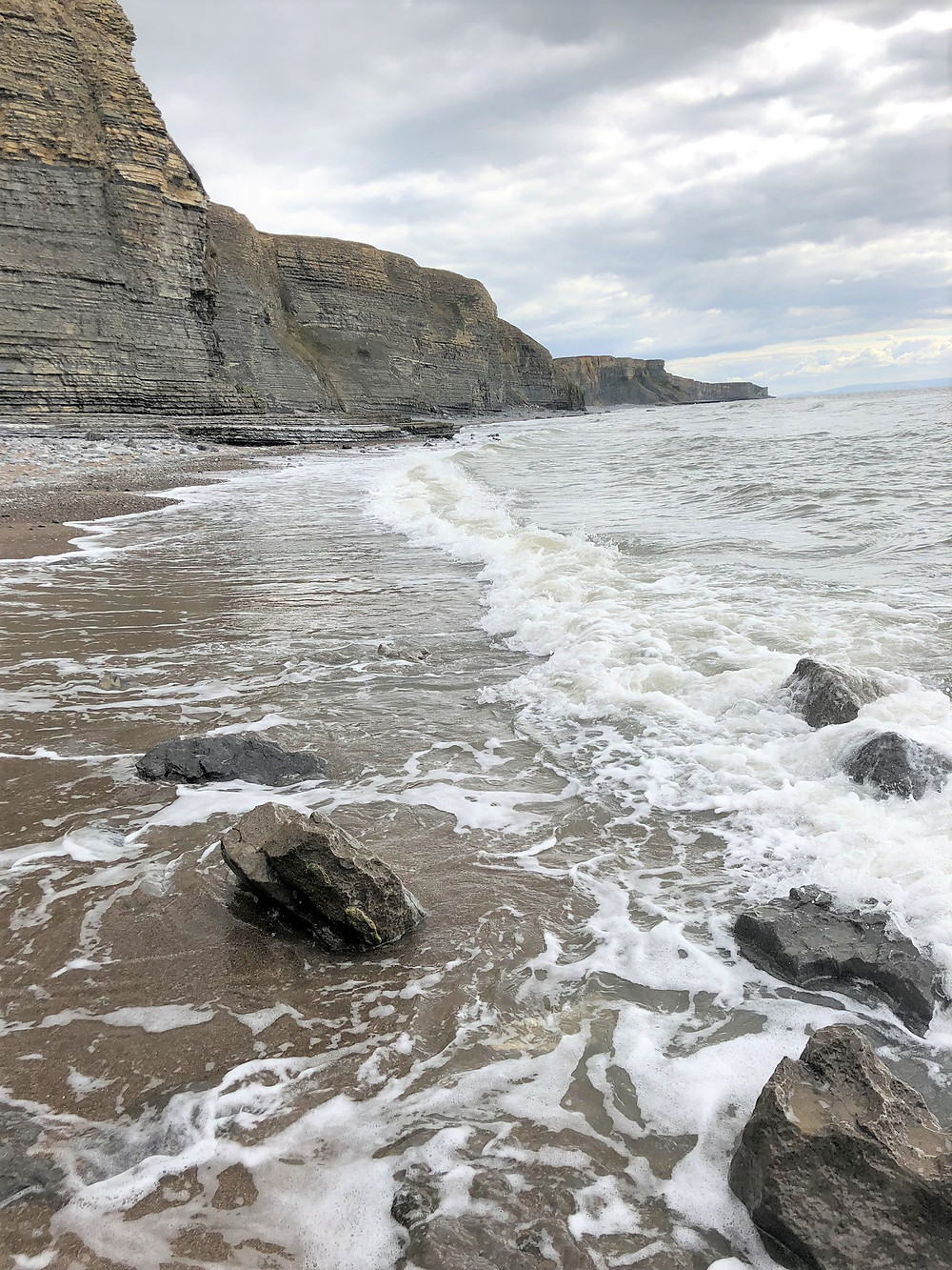 Low tide at the beach at the base of the Jurassic Cliffs of Wales along the Glamorgan Heritage Coastal Trail