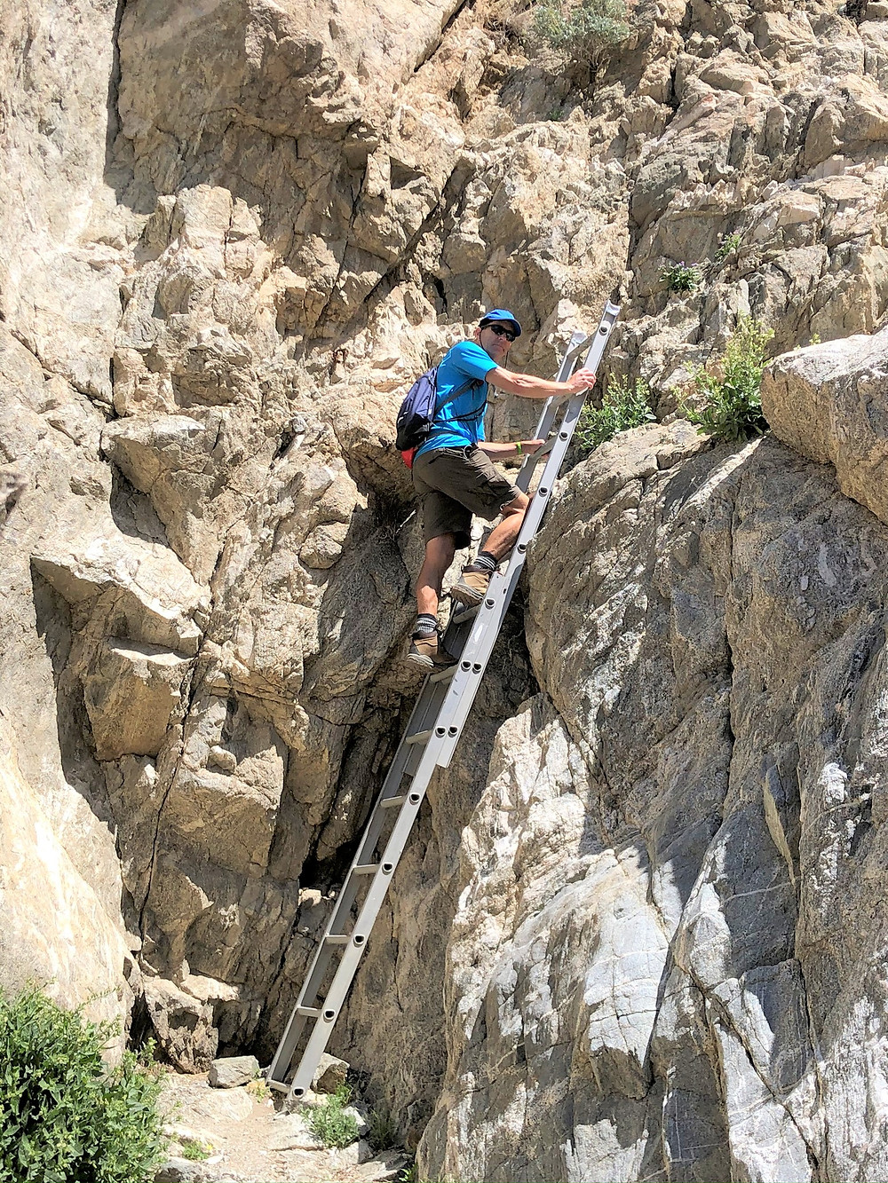 Descending by ladder on the Chocolate Drop Trail in the foothills of the Little San Bernardino Mountains in Desert Hot Springs