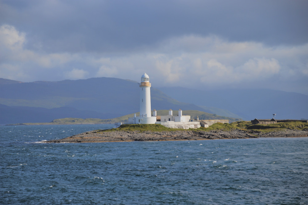 Lismore Lighthouse from the CalMac ferry approaching the Isle of Mull in Scotland