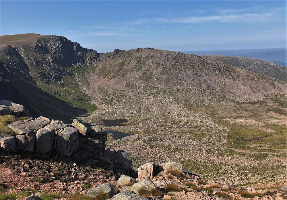 The Coire an t-Sneachda headwall with cliffs reaching 600 feet high.  Fiacaill Coire an t-Sneachdaand is the ridge directly across the basin