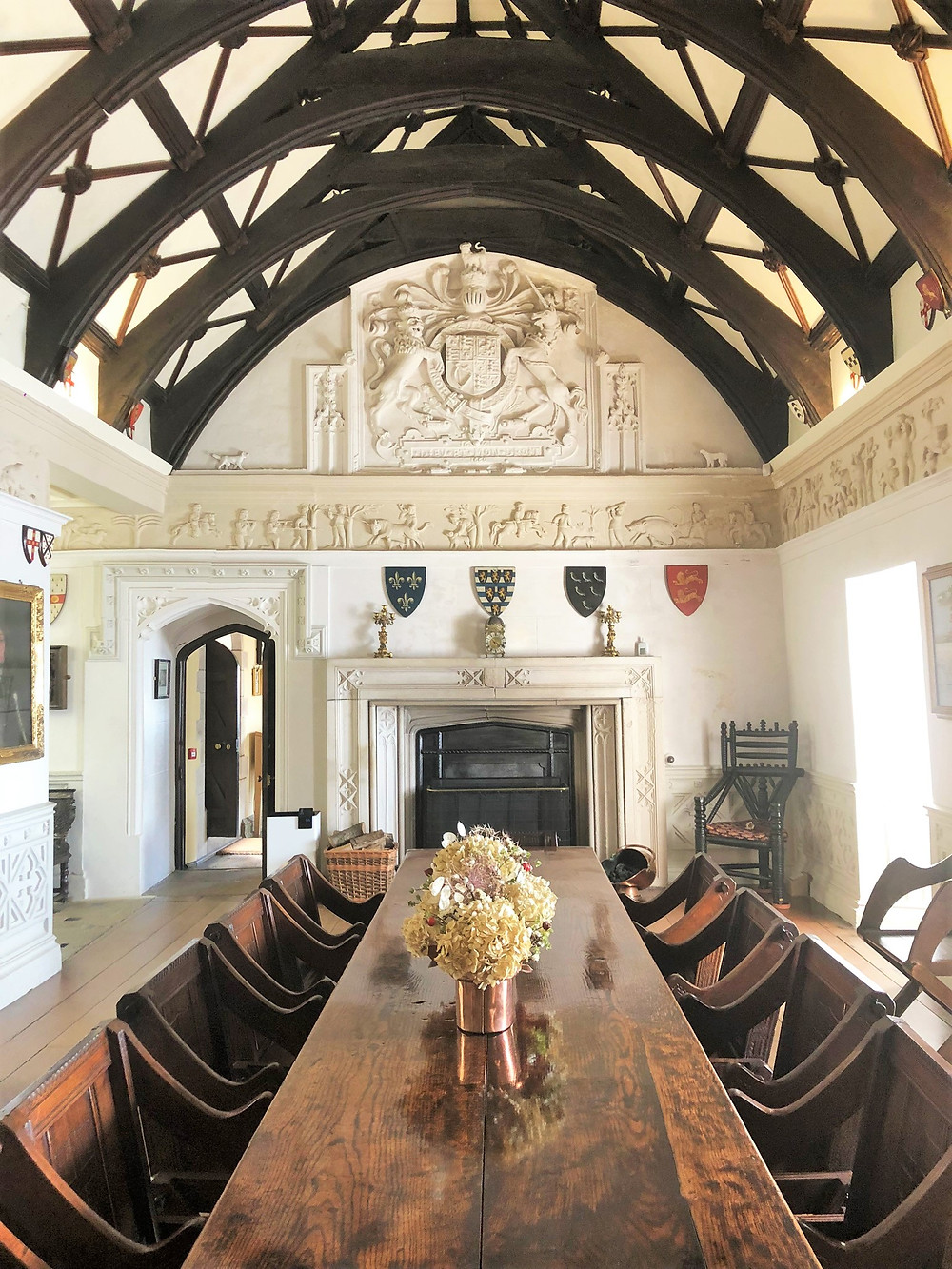 The Tudor Great Hall in St Michael's Mount castle. An oak table with monastic chairs makes for an imposing effect.