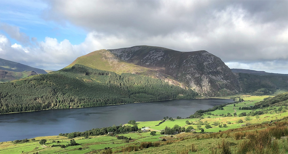 Views of toward Llyn Cwellyn and the crags of Mynndd Mawr on the Ranger Path leading to the summit of Snowdon