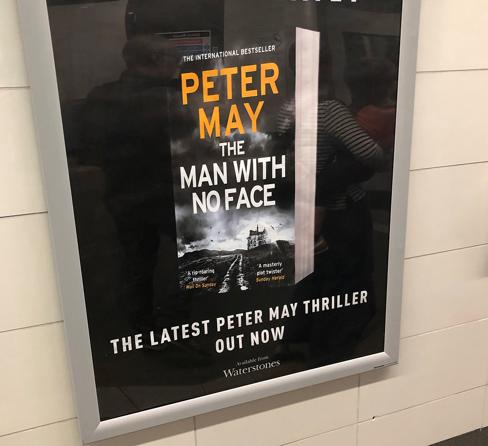 Advertisement in Glasgow subway for Peter May book The Man with No Face