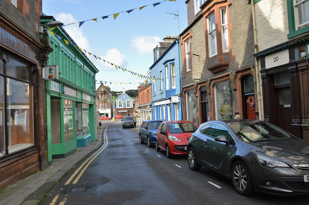 Shops on main road through Village of Moffat in Scotland