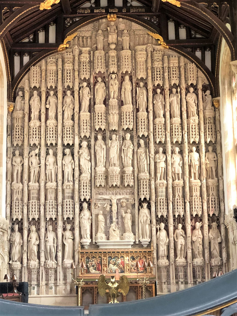 The high altar in the Chapel at All Souls surrounded by statues of saints, bishops and monarchs in All Souls College in Oxford, England