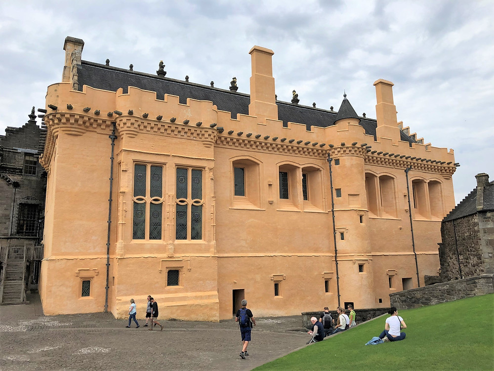 The restored gold colored Great Hall in Stirling Castle was built by King James IV between 1501 and 1503 as a magnificent banqueting hall measuring 138 by 47 feet.