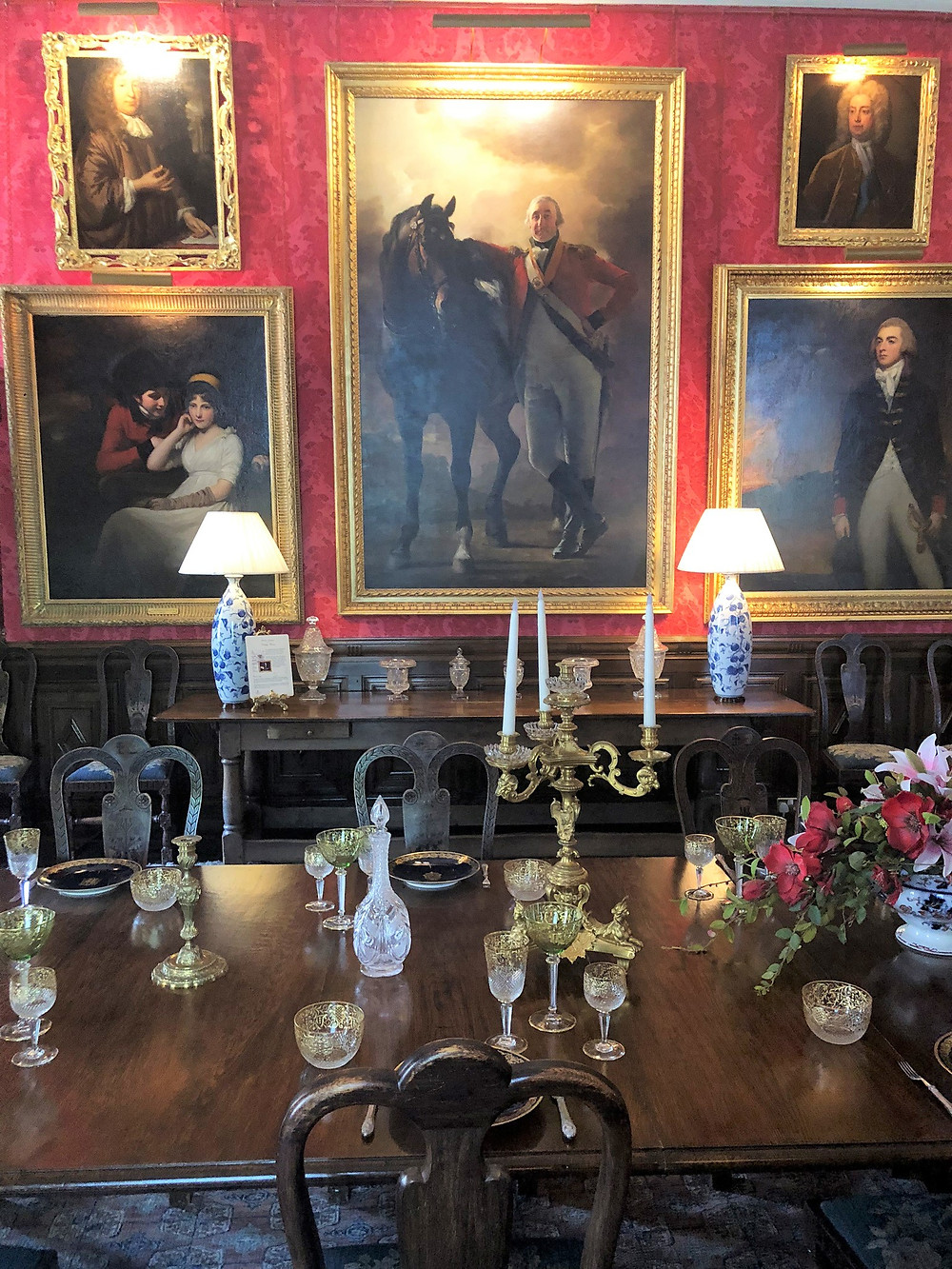 Paintings in the family dining room above dining room table in Fyvie Castle in Aberdeenshire, Scotland