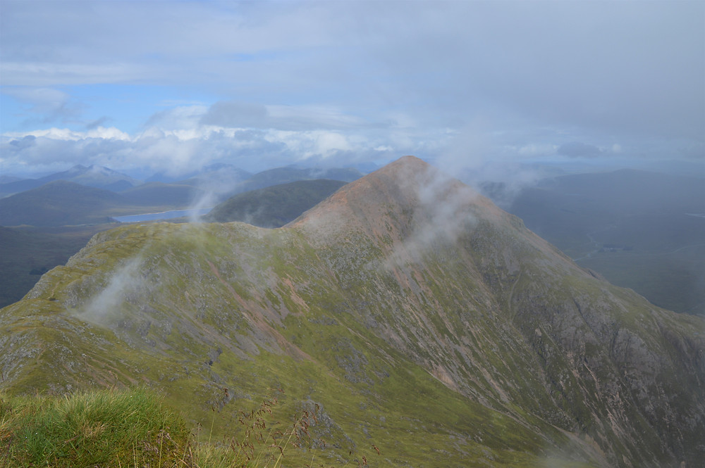 Clouds hovering over the summit of Stob Dearg on Buachaille Etive Mòr taken from the summit of Stob Na Doire