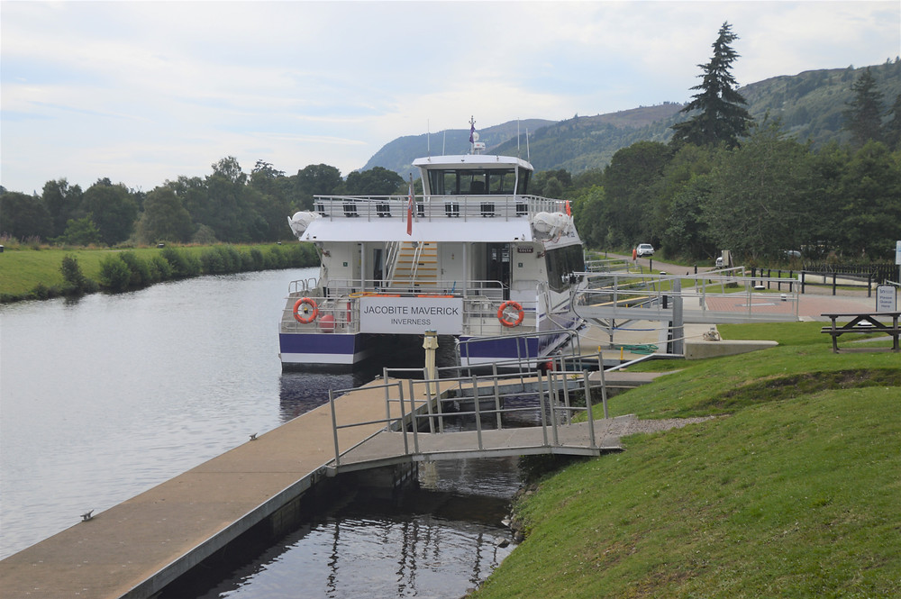 Boarding the Jacobite cruise of Loch Ness on the  Maverick at a pier adjacent to the Dochgarroch Lock on the Caledonian Canal