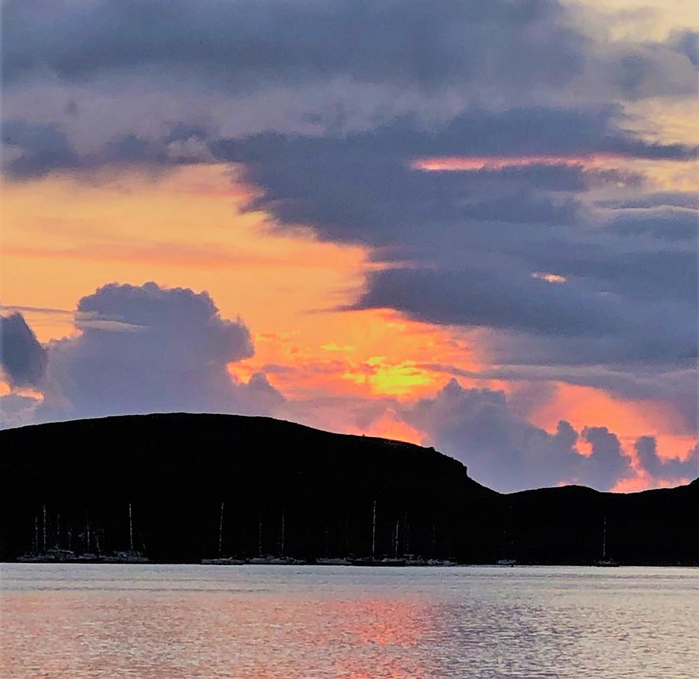 Sunset over Oban harbor in Scotland