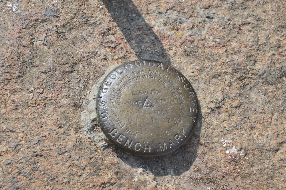 Geodetic survey marker at summit of Mt Pierce in the Presidential Mountain Range. 4000 footer