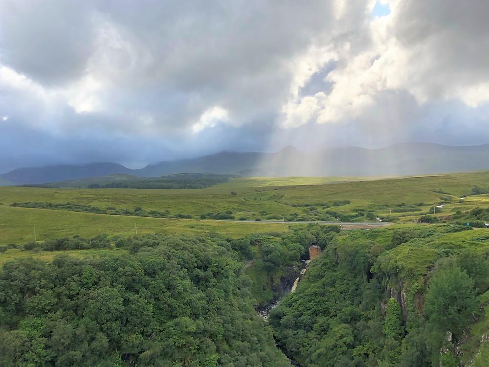 Green lush lands of Lealt Falls on the Isle of Skye