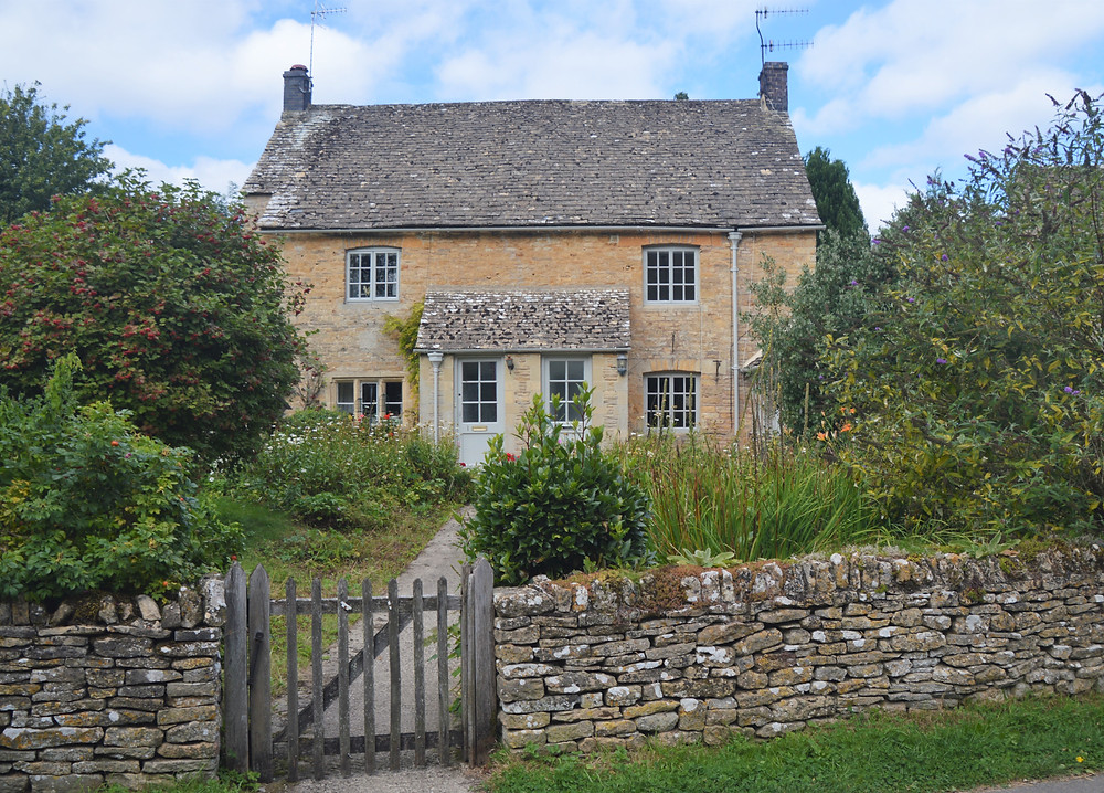 Home in Upper Slaughter made of Cotswold yellow limestone.