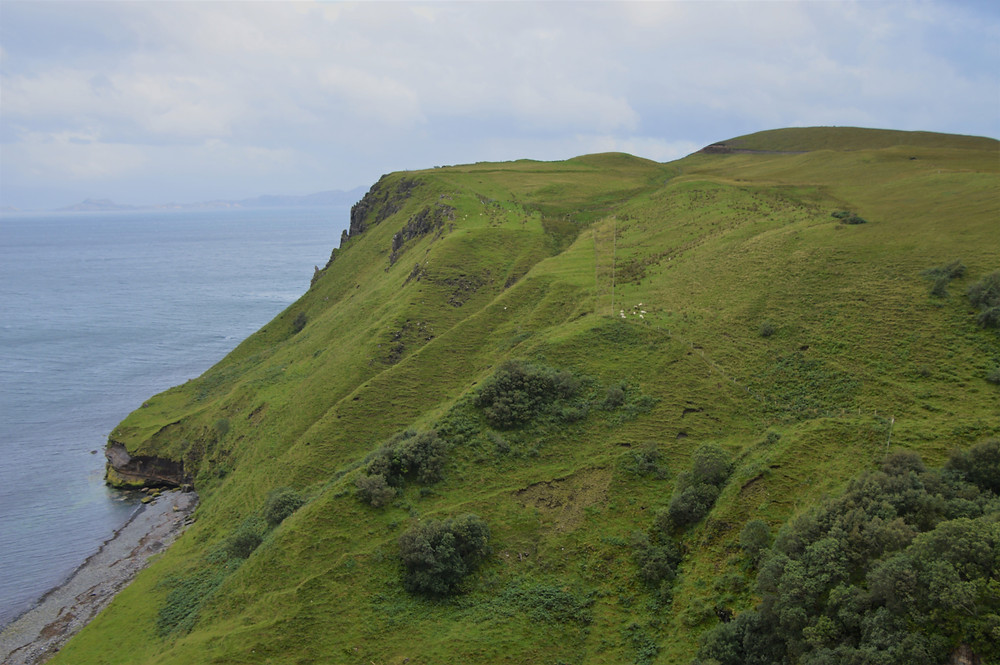 Green hills and sea cliffs at Lealth Falls on the Isle of Skye