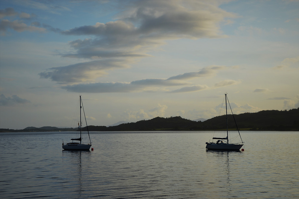 Sunset and sail boats on Loch Laich in the Scottish Highlands