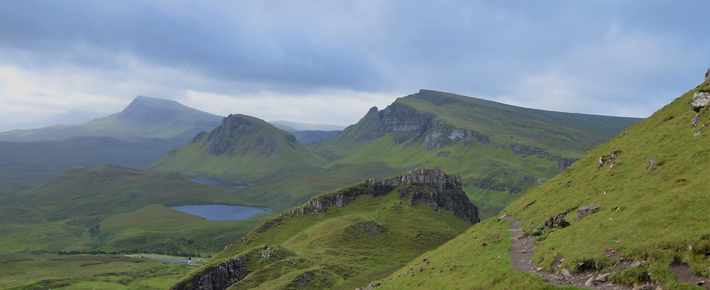 Streams pouring over the Meall na Suiramach's cliffs located above the Quiraing trail on the Isle of Skye